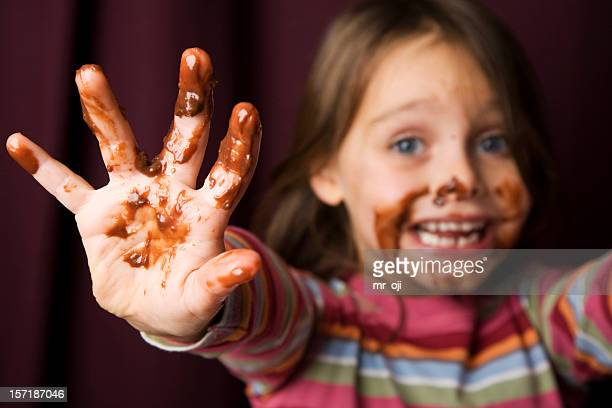 young girl covered in chocolate. - forbidden stock pictures, royalty-free photos & images