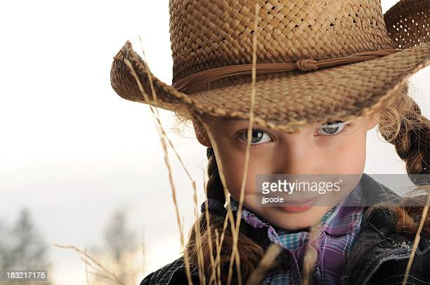 young girl, cowboy hat - cowgirl hairstyles stock photos and pictures