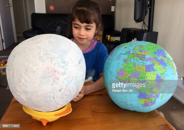 Young girl creating a globe