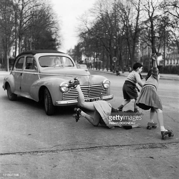Young Girl Crossing The Street On Roller Skates On Chaussee De La Muette In Paris 1955