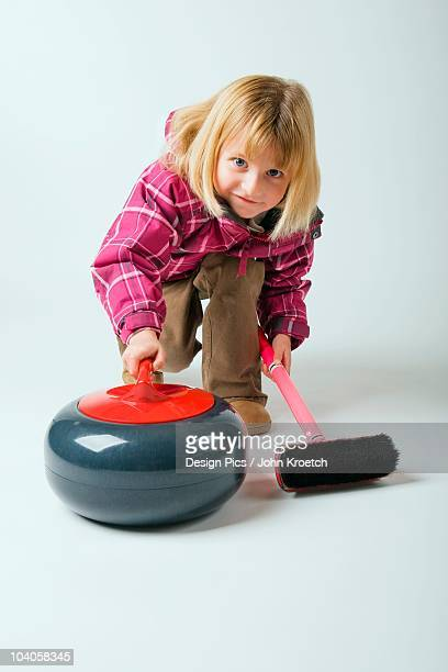 A Young Girl Curling