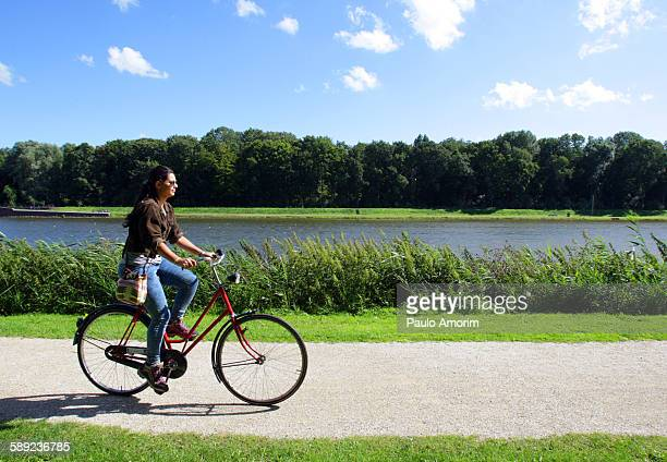 A young girl cycling on the park in Amsterdam
