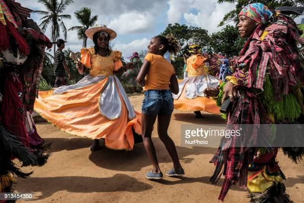 A young girl dances with her friends during a presentation of Maracatu in the city of Nazaré da Mata in Northeast Brazil on January 14 2018