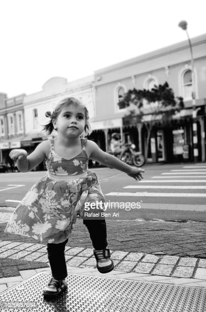 Young Girl Dancing in the Street