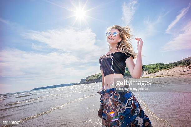 young girl dancing on a beach - gower peninsula stock photos and pictures