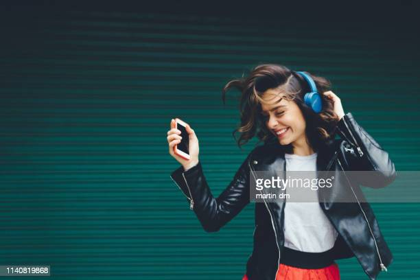young girl dancing to the music - bambine femmine foto e immagini stock
