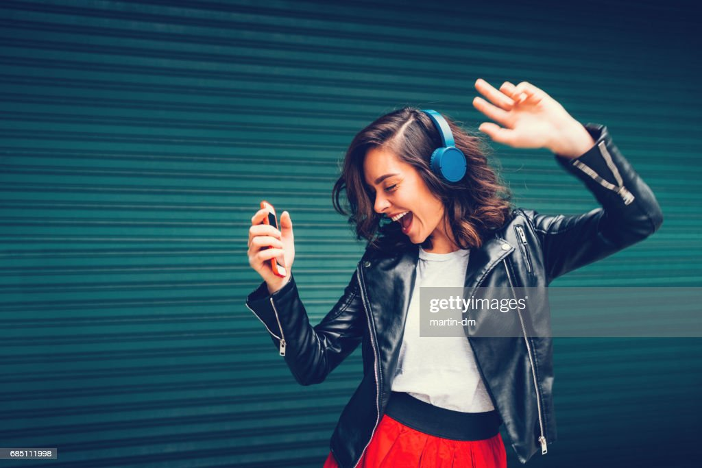 Young girl dancing to the music : Stock Photo