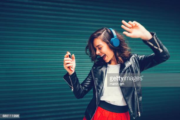young girl dancing to the music - allegro foto e immagini stock