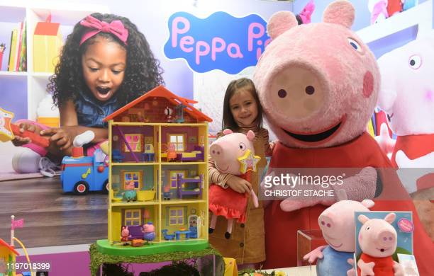 Young girl Daria plays with Peppa Pig toys at the booth of Jazwares company during the press preview of the international toys fair Spielwarenmesse...
