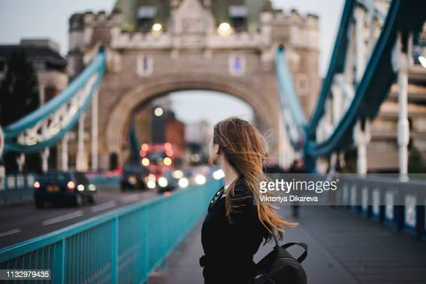 young girl discovery london - tower bridge. london tourist. - london england stock-fotos und bilder