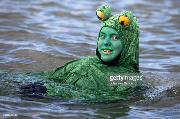 A young girl disguised as frog participates in the traditional Neuburg ice swimming on January 31 2009 in Neuburg an der Donau Germany The Neuburg...