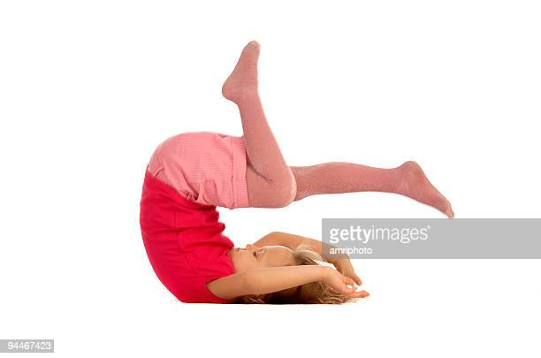 young girl doing a somersault - somersault stock pictures, royalty-free photos & images
