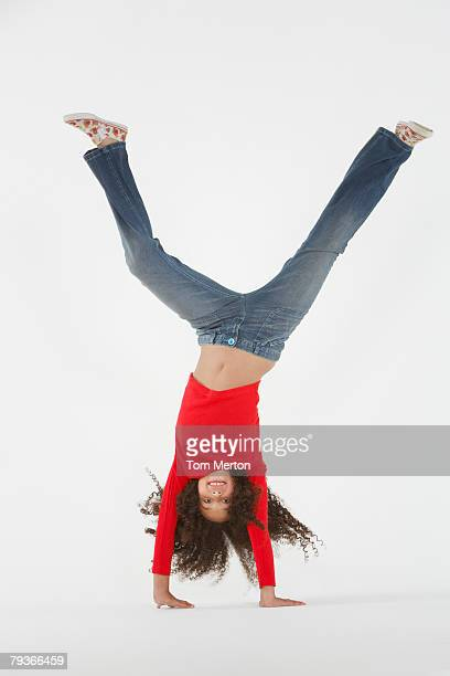 young girl doing cartwheel indoors - cartwheel stock pictures, royalty-free photos & images