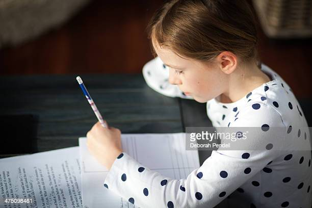 Young girl doing her homework