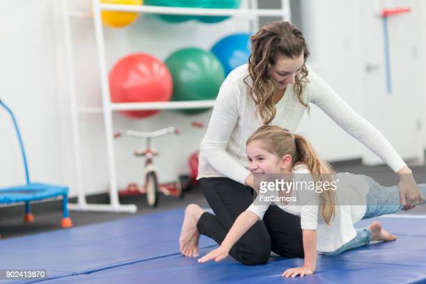 Young Girl Doing Physical Therapy at Modern Clinic