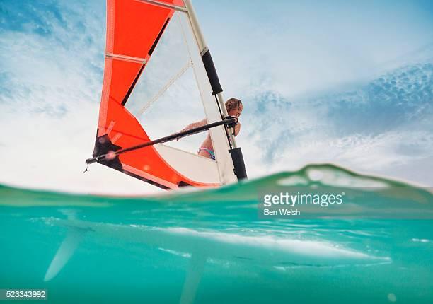 Young girl doing windsurf.