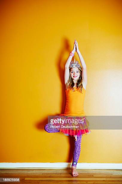 A young girl doing yoga.