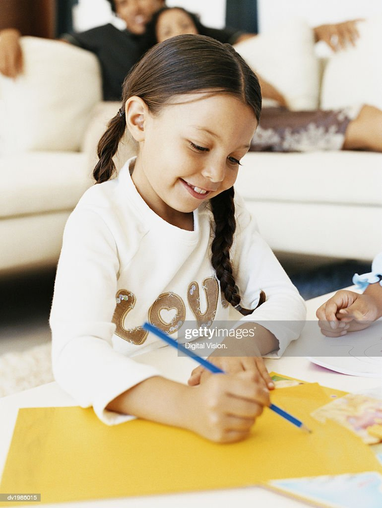 Young Girl Drawing a Picture : Stock Photo