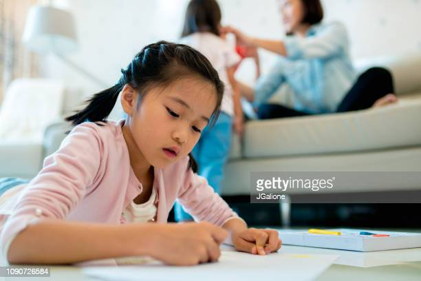 Young girl drawing at home