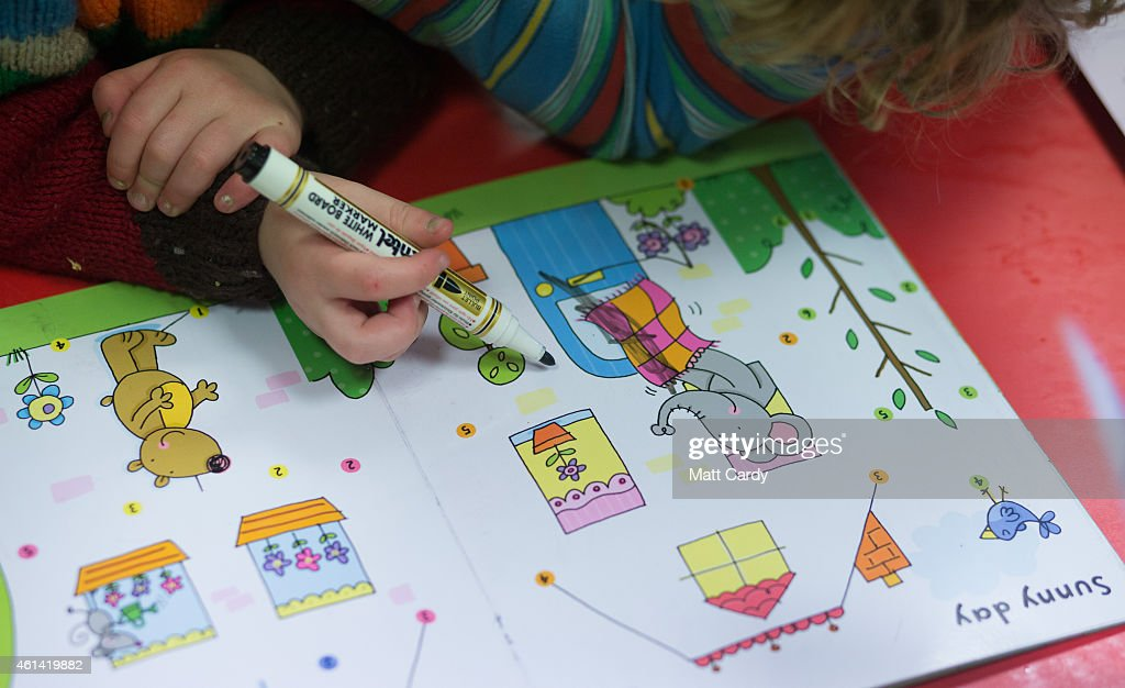 A young girl draws at a playgroup for pre-school aged children in Chilcompton near Radstock on January 6, 2015 in Somerset, England. Along with the health and the economy, education and childcare are to be key issues in the forthcoming election.