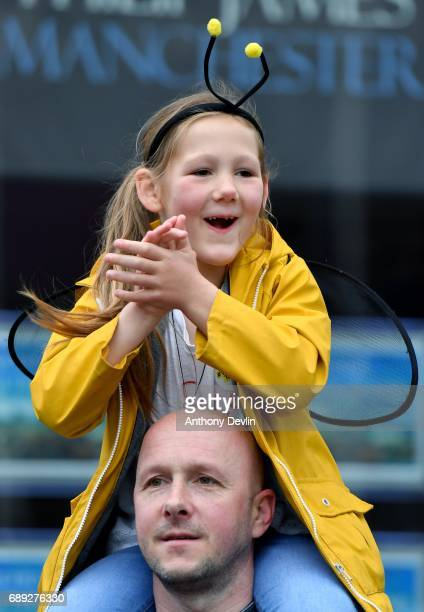 A young girl dressed as a bee cheers on runners in the Simplyhealth Great Manchester Run on May 28 2017 in Manchester England Security in the city...