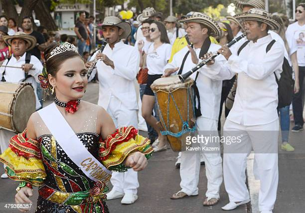 BARRANQUILLA COLOMBIA JANUARY 26 2014 A young girl dressed as a Capitana walks in front of musicians in the procession of Children's Carnival on...