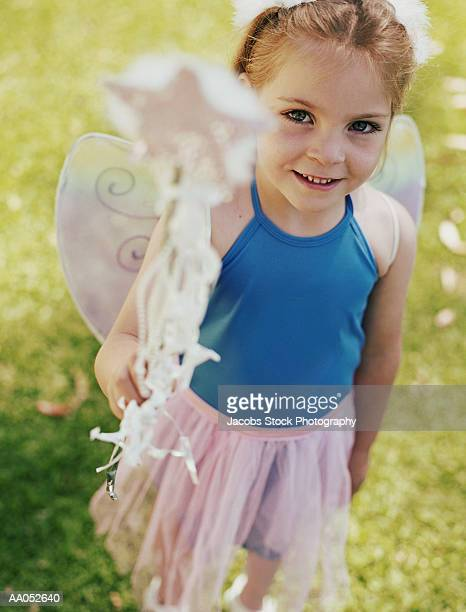 Young girl (4-6) dressed as ballerina (selective focus)