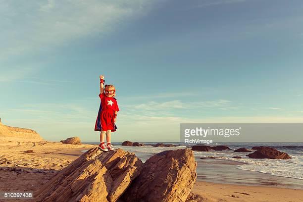 Young Girl dressed as Superhero on California Beach