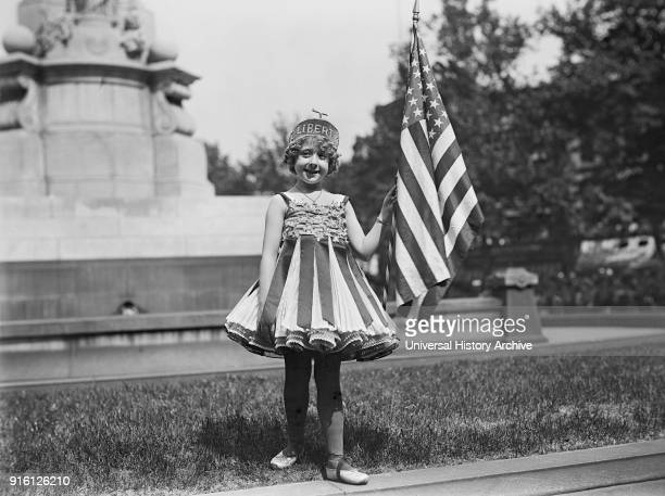 Young Girl Dressed in Liberty Costume with American Flag Fourth of July Celebration Washington DC USA Harris Ewing 1916