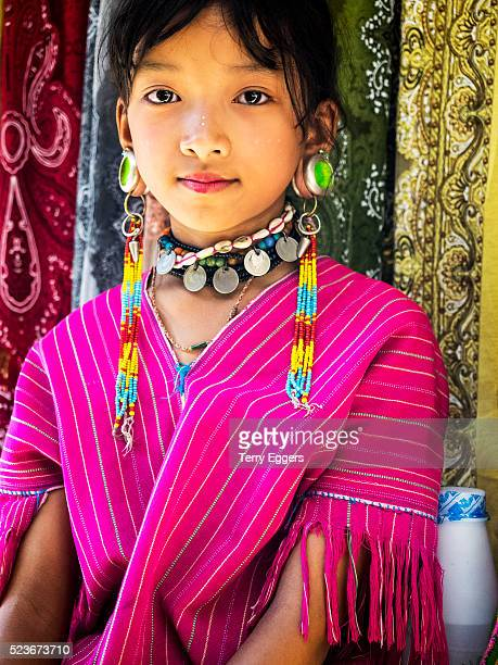 Young girl dressed in traditional village clothing