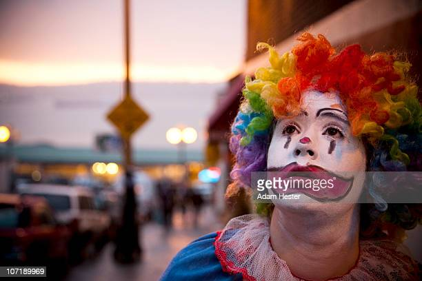 a young girl dressed up as a clown. - sad clown stock photos and pictures