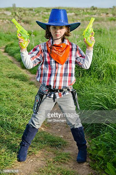 young girl dressed up as a cowgirl - white boot stock pictures, royalty-free photos & images