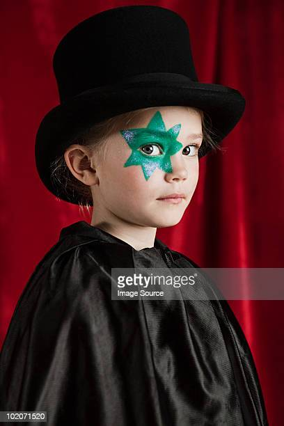 young girl dressed up as magician wearing top hat - magician stock pictures, royalty-free photos & images