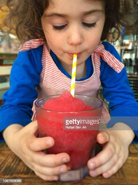 Young girl Drinking a Frozen Raspberry Drink