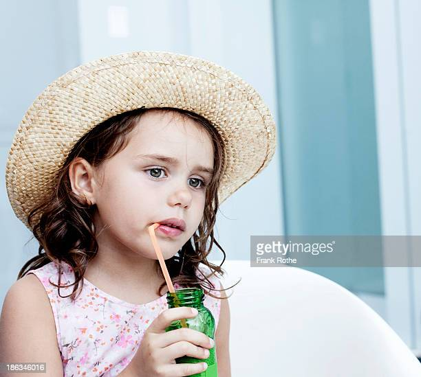 young girl drinking a softdrink