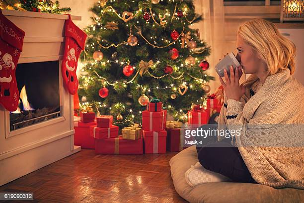 Young Girl Drinking Tea on Christmas Eve