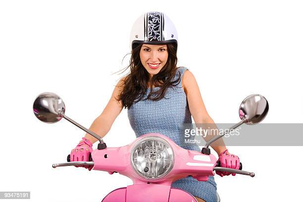 Young girl driving a Vespa