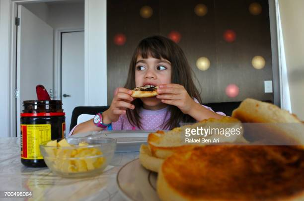 Young girl eat muffin splits
