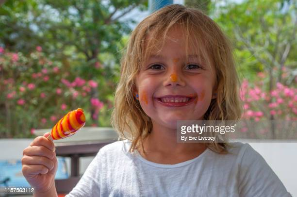 young girl eating an ice lolly - hot dirty girl stock photos and pictures