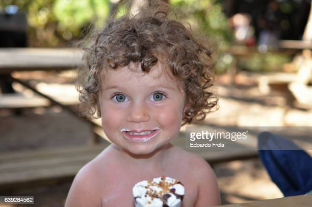 young girl eating ice cream cone. - hot dirty girl stock photos and pictures