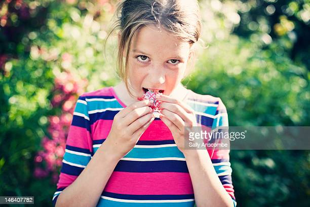 young girl eating union jack cupcake - british flag cake stock pictures, royalty-free photos & images