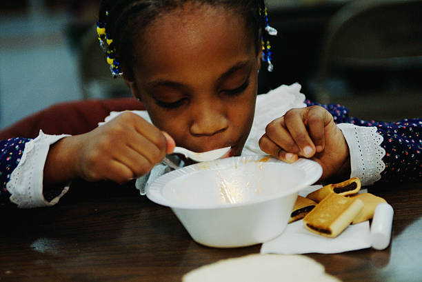 child eating at soup kitchen in new york pictures getty images