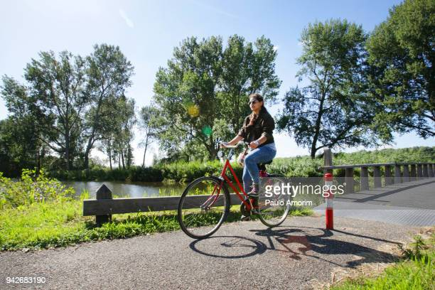 a young girl enjoying at bosbaan park in amsterdam - noord holland stockfoto's en -beelden