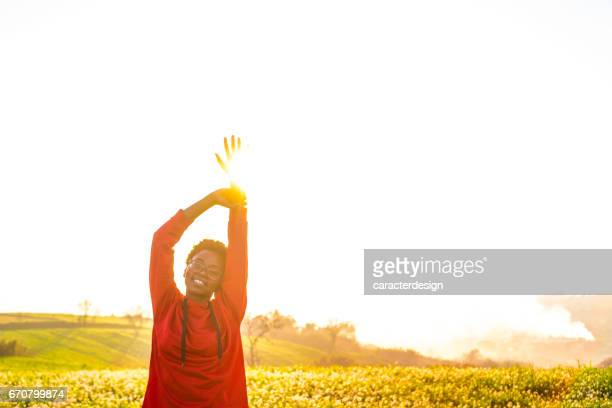 young girl enjoying in nature - red shirt stock pictures, royalty-free photos & images