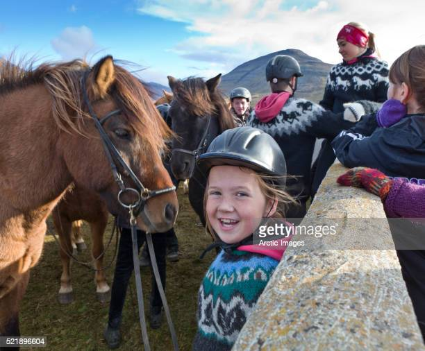 Young girl enjoying the day at the annual horse round up, Laufskalarett, Iceland