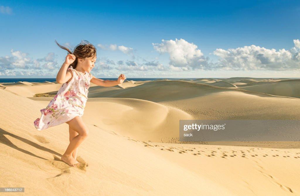 Young girl enjoying the dunes near the beach : Stock Photo
