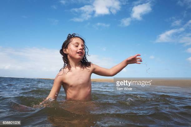 young girl enjoying the ocean - free six photo stockfoto's en -beelden