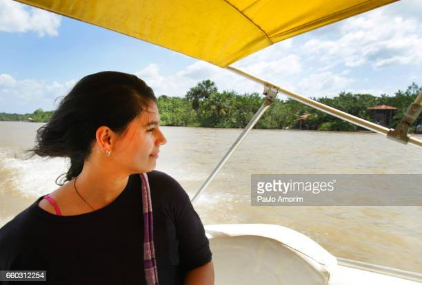 A young girl enjoying the view in Amazon,Brazil