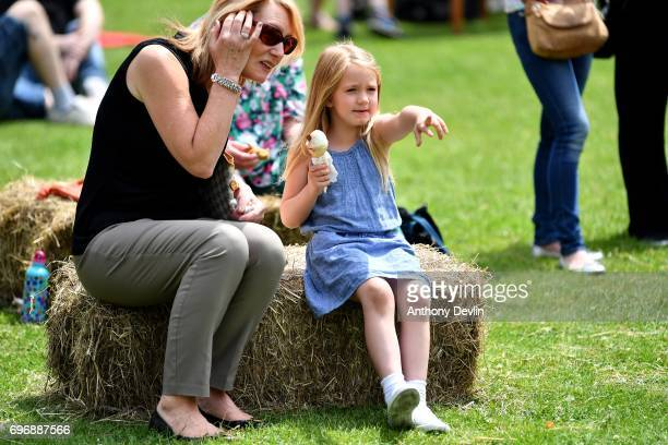A young girl enjoys an ice creams as people attend a Great Get Together event in memory of murdered MP Jo Cox on June 17 2017 in Heckmondwike England...