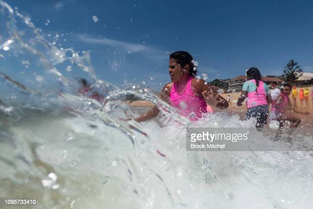 A young girl enjoys her first ever swim in the ocean at South Narrabeen Beach on January 18 2019 in Sydney Australia The 40 children from Far North...